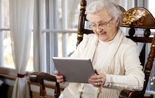 Senior woman connecting with family on a tablet