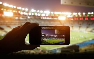 Iphone filming ballgame at large venue